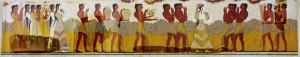 Corredor de las procesiones, fresco con imágenes a tamaño natural del palacio de Cnoso, Museo de Heraklion. Por dicho corredor debió de discurrir, en las celebraciones solemnes, el cortejo real: el rey y su séquito, sacerdotes, músicos y los portadores de ofrendas.
