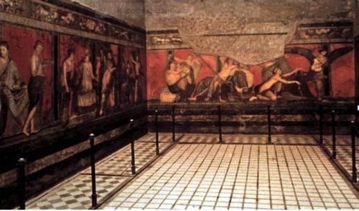 Fresco en una de las habitaciones de la Villa de los Misterios en Pompeya. En él se representa el rito de iniciación en los misterios de Baco.